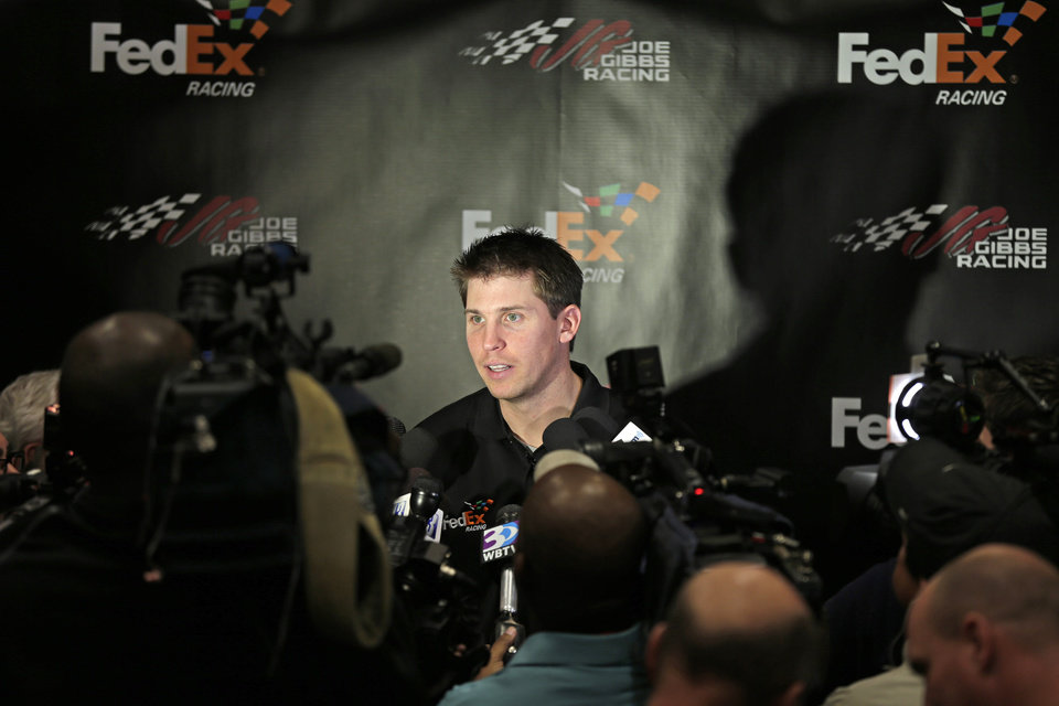 Denny Hamlin answers questions from the media during a news conference at Joe Gibbs Racing in Huntersville, N.C., Thursday, Jan. 24, 2013, as part of the NASCAR Sprint Cup Media Tour. (AP Photo/Chuck Burton)
