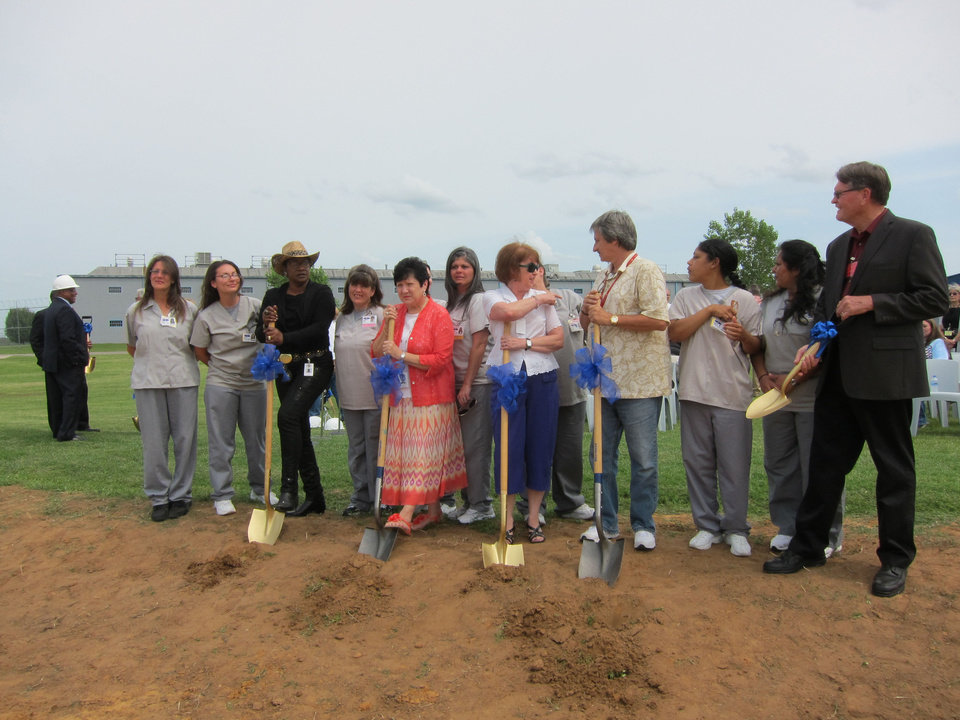 Photo - Inmates join with volunteers from the faith community to celebrate the groundbreaking of the new chapel to be built in September at Mabel Bassett Correctional Center in McLoud.   Carla Hinton - The Oklahoman