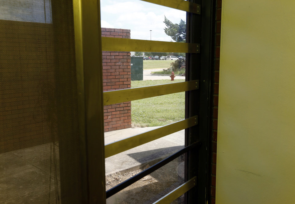 Photo -  Some areas are separated from the public by only a barred glass door and a single lock at the Oklahoma Juvenile Center for Girls in Norman. [Photo by Steve Sisney, The Oklahoman]