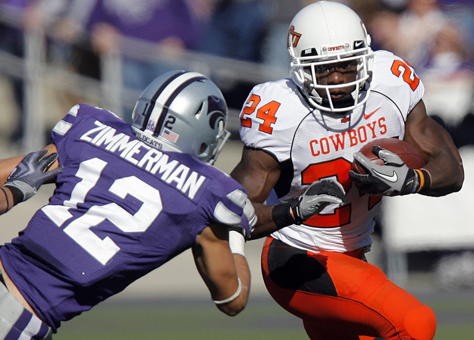 Oklahoma State's Kendall Hunter (24) runs past Kansas State's Ty Zimmerman (12) during the first half of the college football game between the Oklahoma State University Cowboys (OSU) and the Kansas State University Wildcats (KSU) on Saturday, Oct. 30, 2010, in Manhattan, Kan.   Photo by Chris Landsberger, The Oklahoman