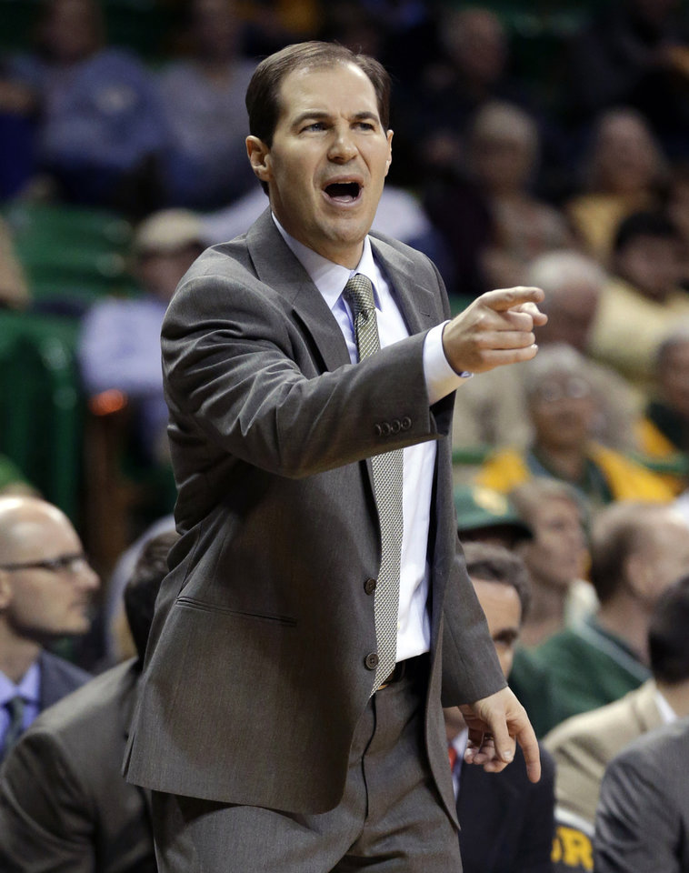 Baylor head coach Scott Drew instructs his team in the first half of an NCAA college basketball game on Wednesday, Dec. 12, 2012, in Waco, Texas. (AP Photo/Tony Gutierrez)