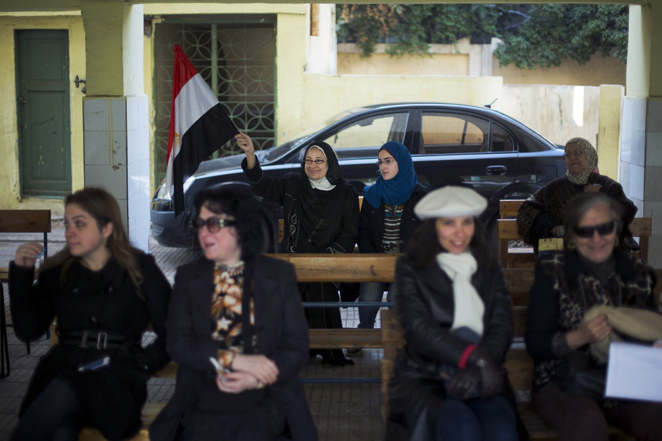 Photo - Egyptian women wait in a polling station to cast their votes in the country's constitutional referendum in Cairo, Egypt, Tuesday, Jan. 14, 2014. Egyptians have started voting on a draft for their country's new constitution that represents a key milestone in a military-backed roadmap put in place after President Mohammed Morsi was overthrown in a popularly backed coup last July.(AP Photo/Khalil Hamra)