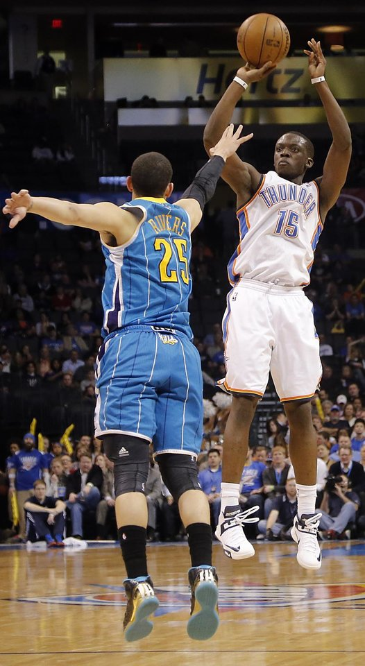 Photo - Oklahoma City Thunder's Reggie Jackson (15) shoots over New Orleans Hornets' Austin Rivers (25) during the NBA basketball game between the Oklahoma City Thunder and the New Orleans Hornets at the Chesapeake Energy Arena on Wednesday, Feb. 27, 2013, in Oklahoma City, Okla. Photo by Chris Landsberger, The Oklahoman