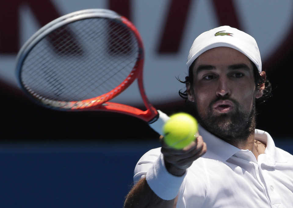 France's Jeremy Chardy hits a forehand return to Italy's Andreas Seppi during their fourth round match at the Australian Open tennis championship in Melbourne, Australia, Monday, Jan. 21, 2013. (AP Photo/Rob Griffith)