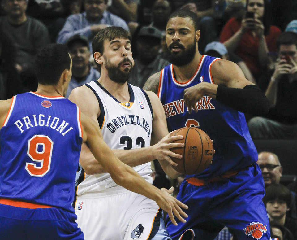 Photo - Memphis Grizzlies center Marc Gasol (33), of Spain, gets blocked in by New York Knicks guard Pablo Prigioni (9), of Argentina, and center Tyson Chandler (6) in the first half of an NBA basketball game, Tuesday, Feb. 18, 2014, in Memphis, Tenn. (AP Photo/Lance Murphey)