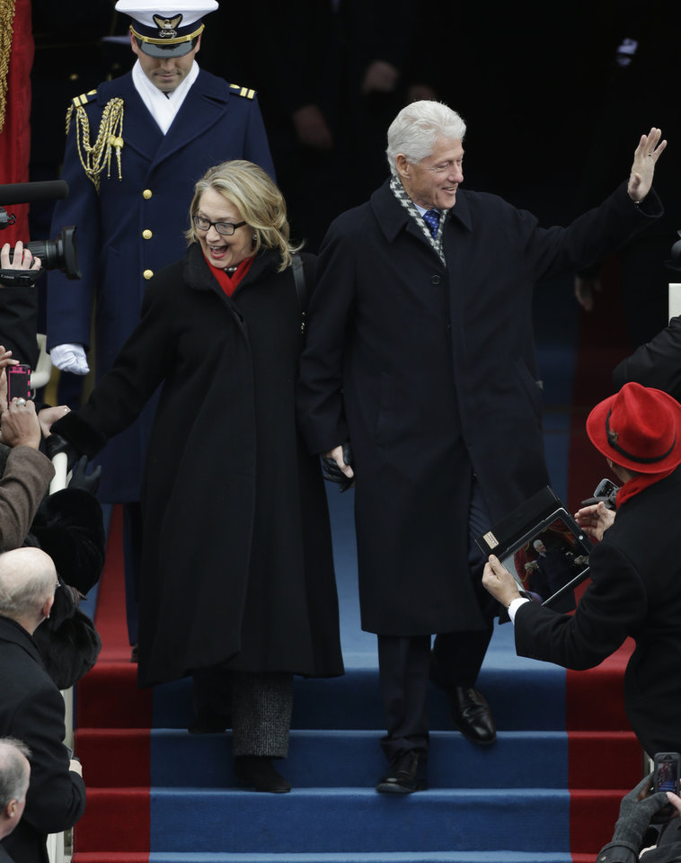 Secretary of State Hillary Clinton and former President Bill Clinton arrive at the ceremonial swearing-in for President Barack Obama at the U.S. Capitol during the 57th Presidential Inauguration in Washington, Monday, Jan. 21, 2013. (AP Photo/Pablo Martinez Monsivais)