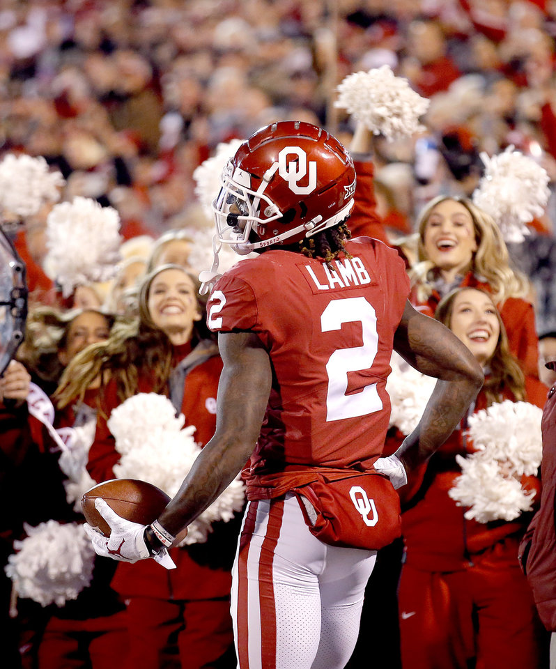 Photo - Oklahoma's CeeDee Lamb (2) celebrates his touchdown in the second quarter during an NCAA football game between the University of Oklahoma Sooners (OU) and the TCU Horned Frogs at Gaylord Family-Oklahoma Memorial Stadium in Norman, Okla., Saturday, Nov. 23, 2019. [Sarah Phipps/The Oklahoman]