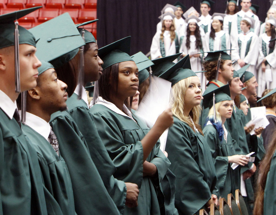 Photo -  Students line up during graduation 2013 ceremonies for Edmond Santa Fe High School at the Cox Convention Center in Oklahoma City. Photo By Paul Hellstern, The Oklahoman Archives   PAUL HELLSTERN -