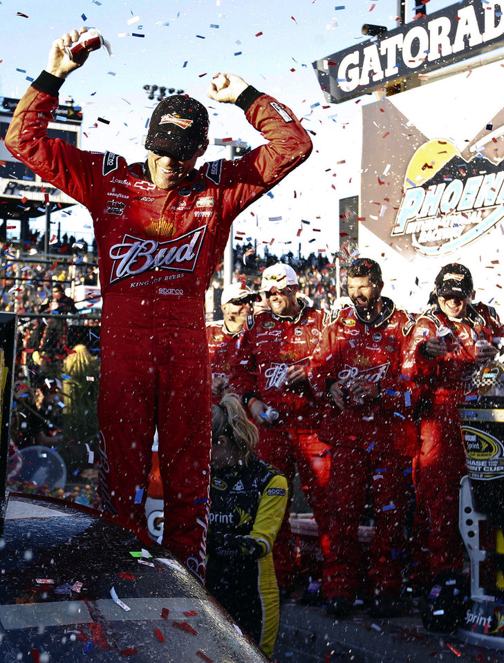 Kevin Harvick celebrates with his pit crew in victory lane after his win at the NASCAR Sprint Cup Series auto race at Phoenix International Raceway, Sunday, Nov. 11, 2012, in Avondale, Ariz. (AP Photo/Ross D. Franklin)
