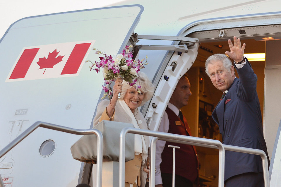 Photo - Prince Charles and his wife Camilla wave as they leave Wednesday, May 21, 2014 in Winnipeg, Canada. (AP Photo/The Canadian Press,  Paul Chiasson)
