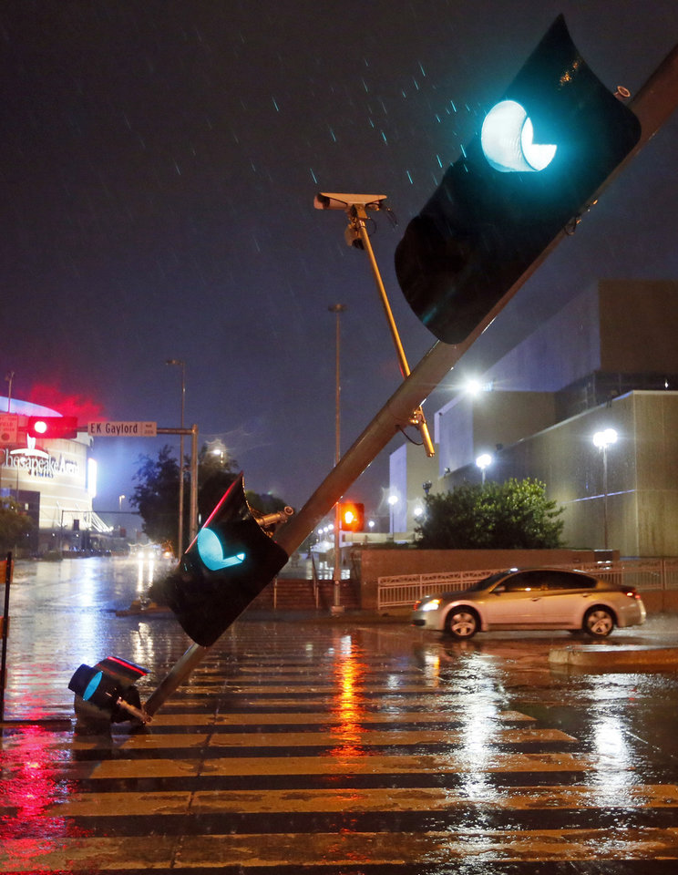 Photo - A traffic signal at E.K. Gaylord and Reno continues to operate after being knocked down in downtown Oklahoma City, Friday, May 31, 2013. Severe Thunderstorms brought tornadoes, high winds, heavy rain and hail to central Oklahoma on Friday. Photo by Nate Billings, The Oklahoman