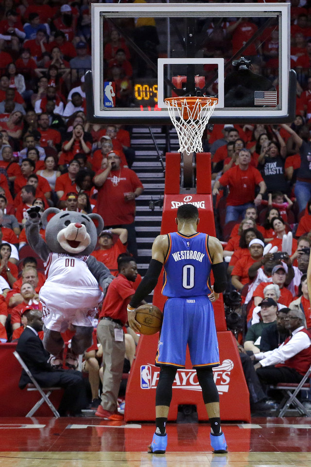 Photo - Oklahoma City's Russell Westbrook (0) prepares to shoot a free throw during Game 5 in the first round of the NBA playoffs between the Oklahoma City Thunder and the Houston Rockets in Houston, Texas,  Tuesday, April 25, 2017.  Houston won 105-99. Photo by Sarah Phipps, The Oklahoman