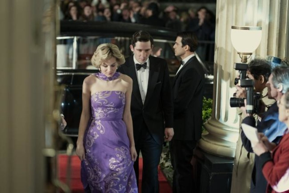 Photo -  This image released by Netflix shows Emma Corrin, left, and Josh O'Connor in a scene from