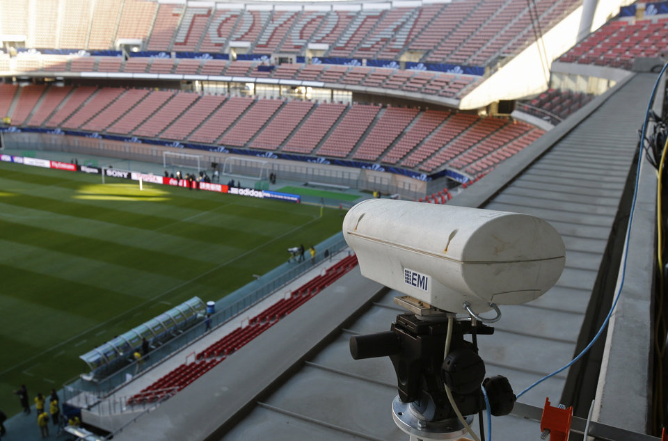 Photo - FILE - In this Saturday, Dec. 8, 2012, file photo, a Hawk-Eye camera is set up at Toyota stadium in Toyota. For the first time at a World Cup, technology will be used to determine whether a ball crosses the goal line during matches at the upcoming tournament in Brazil. With vanishing spray also being used to prevent encroachment by defenders making up a wall during free kicks, officials at the highest level of the world's most popular sport are finally getting some assistance. (AP Photo/Shuji Kajiyama)
