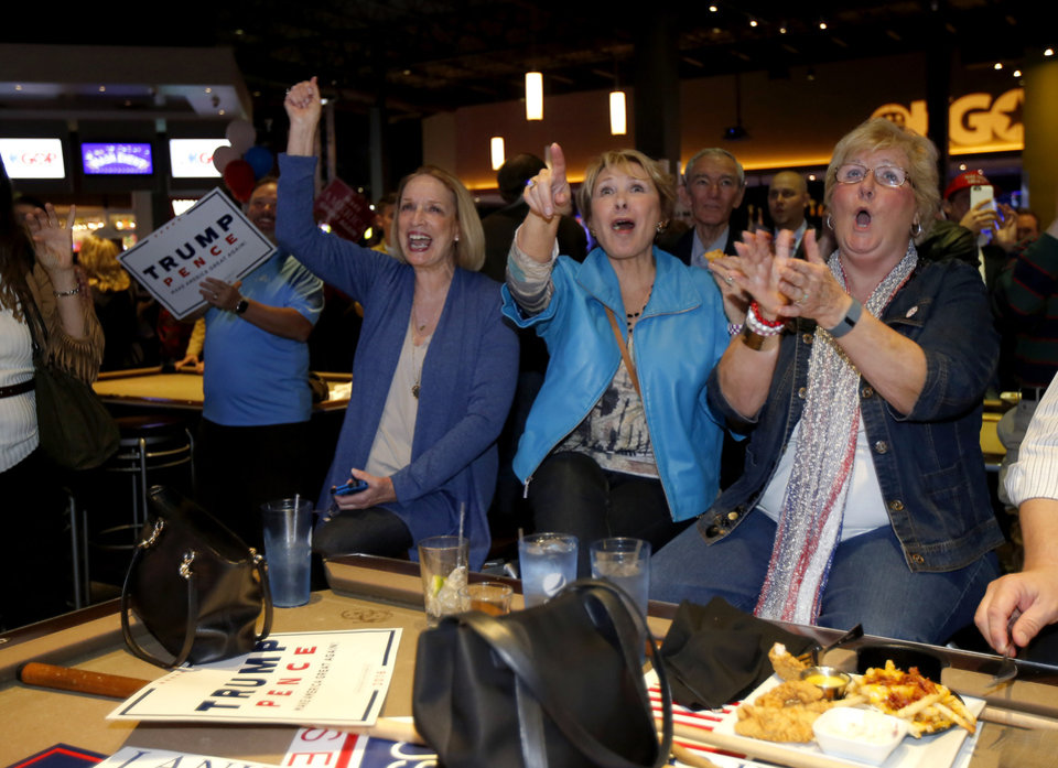Photo - Fron left, Carol Swink, Pat Grisham and Evelyn McCoy, all from Oklahoma City cheer as Republican Party backers gathered Tuesday night at Main Event Entertainment in northwest Oklahoma City as election returns rolled in the presidential race against Donald Trump and Democrat Hillary Clinton. Oklahomans on Tuesday also cast votes on several state ballot measures, a host of legislative contests and other local issues and offices. Photo by Bryan Terry, The Oklahoman
