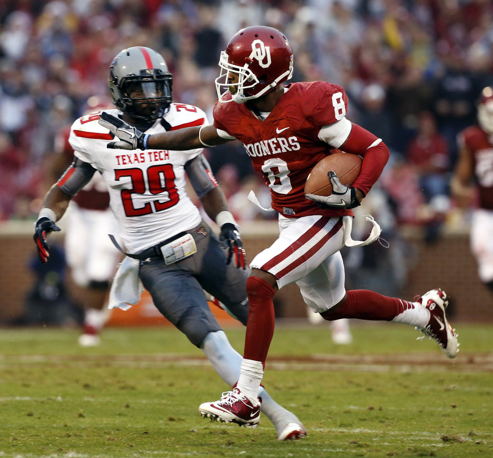 Oklahoma's Jalen Saunders (8) scores on a catch and run during a college football game between the University of Oklahoma Sooners (OU) and the Texas Tech Red Raiders at Gaylord Family-Oklahoma Memorial Stadium in Norman, Okla., on Saturday, Oct. 26, 2013. Photo by Steve Sisney, The Oklahoman
