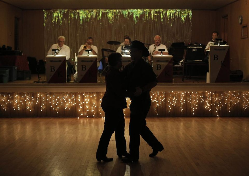 Photo -  John and Joan Bivins, of Edmond, dance while the Milo Schedeck band performs at Czech Hall in Yukon, Okla., Saturday, Sept. 29, 2012.  Photo by Garett Fisbeck, The Oklahoman