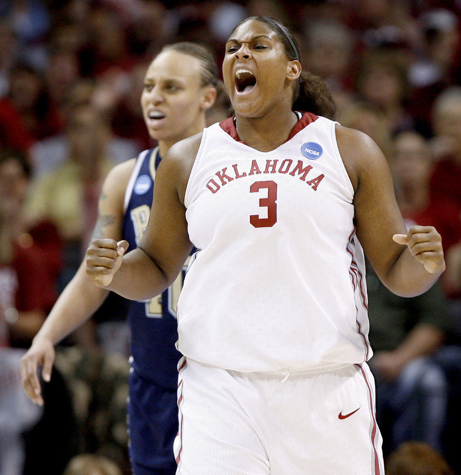 Photo - OU's Courtney Paris celebrates in front of Pittsburgh's Pepper Wilson during the NCAA women's basketball tournament game between Oklahoma and Pittsburgh at the Ford Center in Oklahoma City, Sunday, March 29, 2009.  PHOTO BY BRYAN TERRY, THE OKLAHOMAN