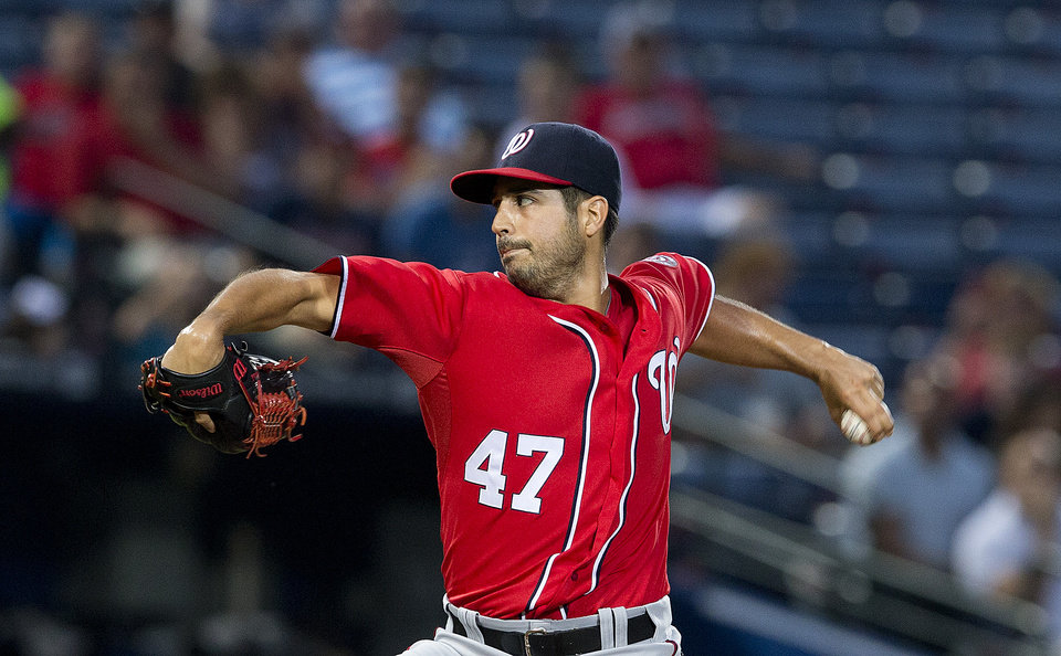 Photo - Washington Nationals starting pitcher Gio Gonzalez (47) works in the first inning of a baseball game against the Atlanta Braves  Sunday, Aug. 10, 2014, in Atlanta. (AP Photo/John Bazemore)