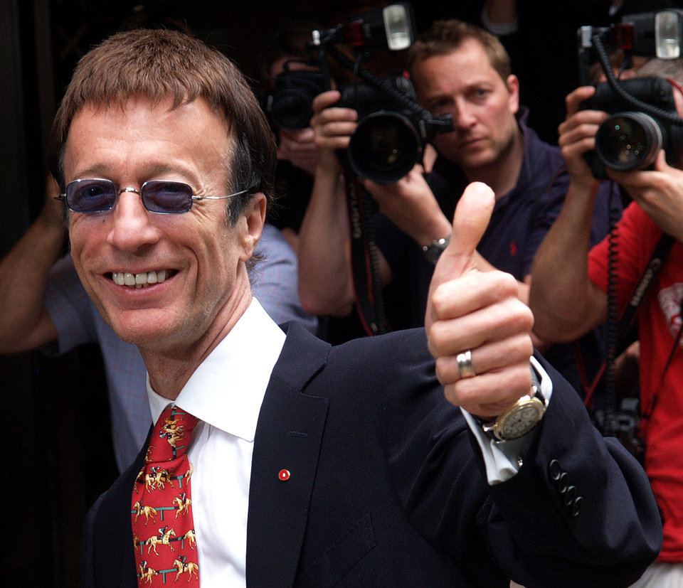 Photo -   FILE - In this May 24, 2007, file photo, Robin Gibb of The Bee Gees arrives at Grosvenor House in London, to attend the Ivor Novello Awards. A representative said on Sunday, May 20, 2012, that Gibb has died at the age of 62. (AP Photo/Max Nash, File)
