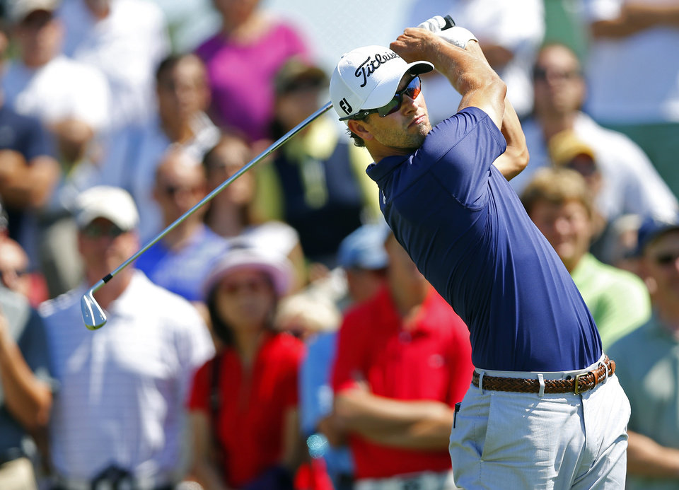 Photo - Adam Scott, of Australia, tees off on the fifth hole during the final round of The Barclays golf tournament Sunday, Aug. 25, 2013, in Jersey City, N.J. (AP Photo/Rich Schultz)