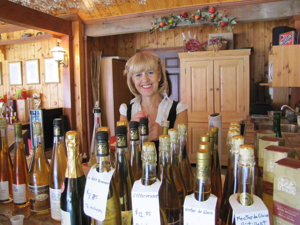Photo -  A bottle of local wine is a perfect souvenir of Quebec City's bucolic Ile d'Orleans. Photo courtesy of Barbara Selwitz.