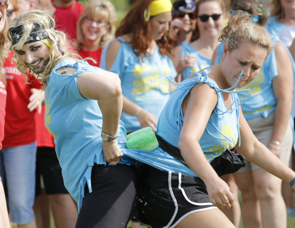 Teri England and Elizabeth Caldwell, with team Girl Scouts, carry a wet sponge in a relay race at the United Way Pacesetter Games, Thursday, June 26, 2014. Photo by Doug Hoke, The Oklahoman