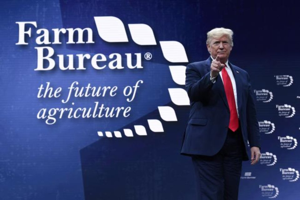Photo - President Donald Trump walks on stage to speak at the American Farm Bureau Federation's convention in Austin, Texas, Sunday, Jan. 19, 2020. (AP Photo/Susan Walsh)
