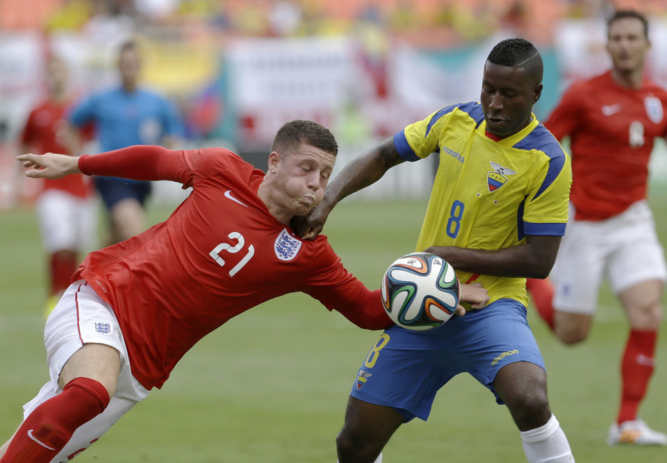 Photo - England's Ross Barkley (21) battles Ecuador's Edison Mendez (8) for control of the ball in the second half of a friendly soccer match in Miami Gardens, Fla., Wednesday, June 4, 2014. The game ended a 2-2 tie. (AP Photo/Alan Diaz)