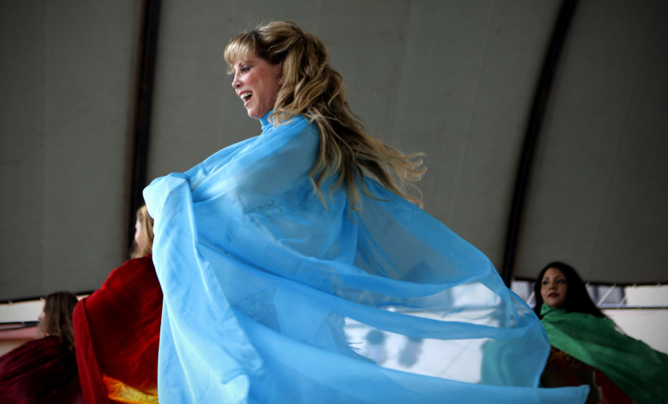 Photo - Left: Kathleen Redwine performs with the Aalim Dance Academy during the Oklahoma Festival of the Arts.  Photos by Bryan Terry,  The Oklahoman