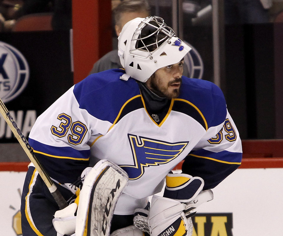 St Louis Blues goaltender Ryan Miller looks on during the pregame skate before an NHL hockey game against the Phoenix Coyotes, Sunday, March. 2, 2014, in Glendale, Ariz. Miller is making his debut with the Blues after being traded from the Buffalo Sabres. (AP Photo/Ralph Freso)