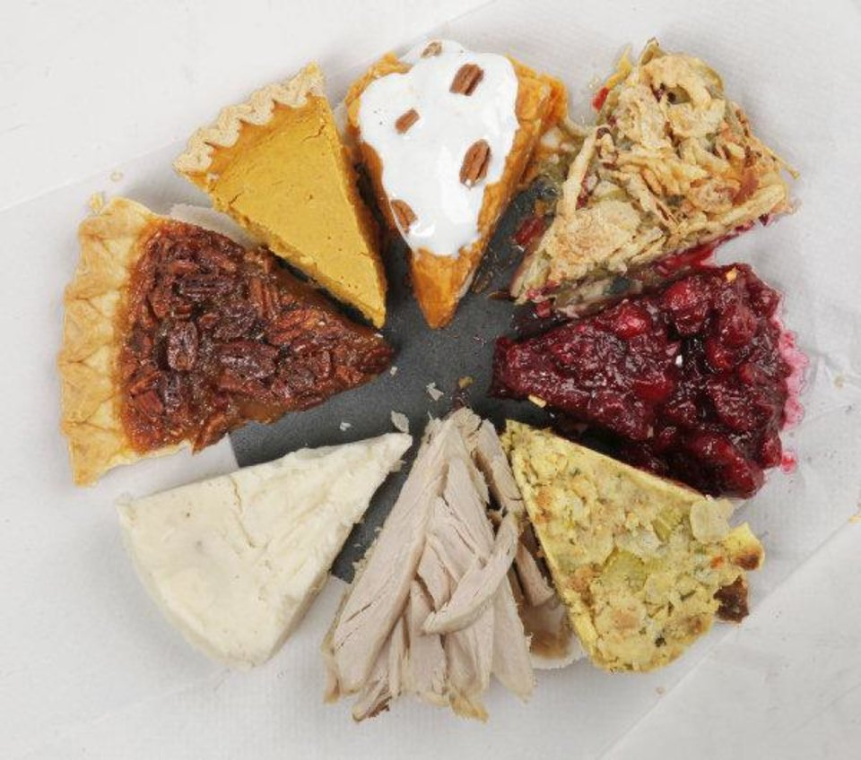 Photo - With America's favorite day to feast eight days away, it's time to review recipes that'll make Thanksgiving easy as pie. Pictured clockwise from top center: sweet potatoes, green bean casserole, cranberry sauce, dressing, turkey, mashed potatoes, pecan pie and pumpkin pie. Photo by Doug Hoke, The Oklahoman <strong>Doug Hoke</strong>