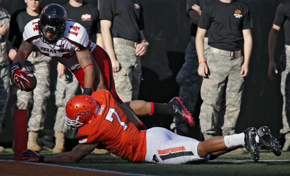 Oklahoma State\'s Shamiel Gary (7) stops Texas Tech\'s Darrin Moore (14) short of the goal line during the college football game between the Oklahoma State University Cowboys (OSU) and Texas Tech University Red Raiders (TTU) at Boone Pickens Stadium on Saturday, Nov. 17, 2012, in Stillwater, Okla. Photo by Chris Landsberger, The Oklahoman