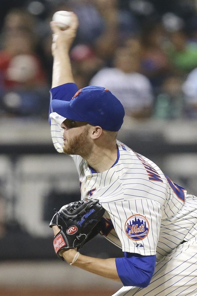 Photo - New York Mets starting pitcher Zack Wheeler throws in the fifth inning of a baseball game against the Atlanta Braves, Wednesday, Aug. 27, 2014, in New York. (AP Photo/John Minchillo)