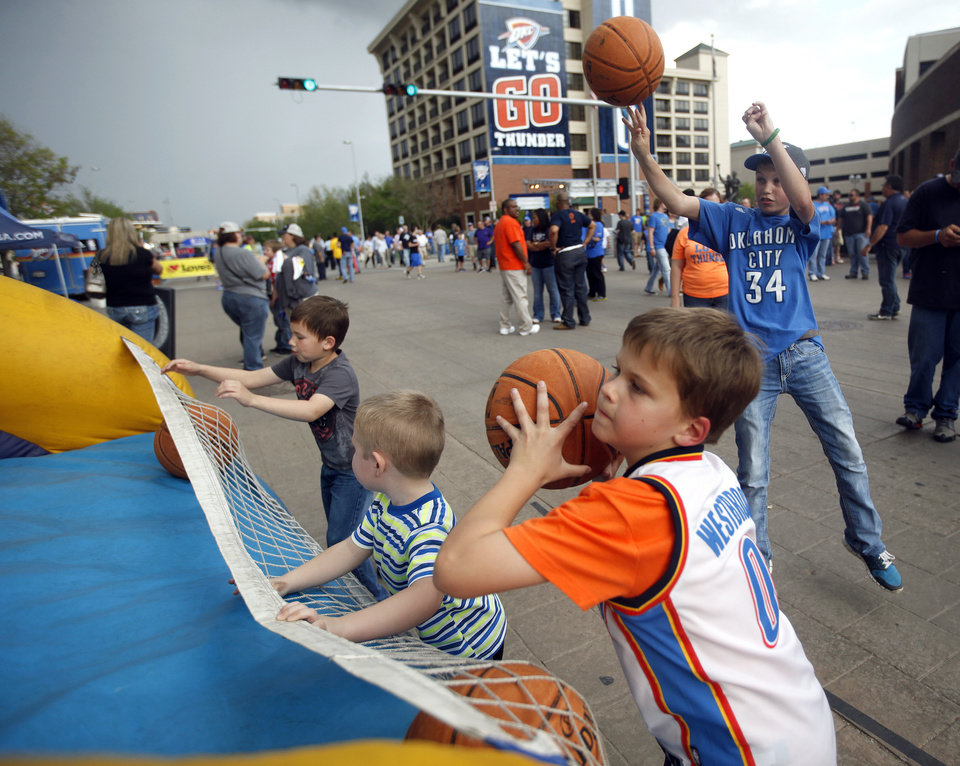 Photo - Tanner Ellis, 8, of Norman, shoots baskets before Game 2 in the first round of the NBA playoffs between the Oklahoma City Thunder and the Memphis Grizzlies at Chesapeake Energy Arena in Oklahoma City, Monday, April 21, 2014. Photo by Sarah Phipps, The Oklahoman
