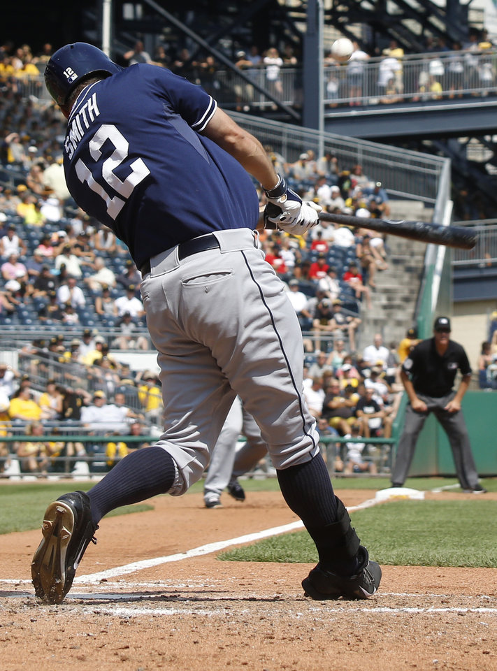 Photo - San Diego Padres' Seth Smith hits a bases-loaded triple driving in three runs against the Pittsburgh Pirates in the fifth inning of the baseball game on Sunday, Aug. 10, 2014, in Pittsburgh. (AP Photo/Keith Srakocic)