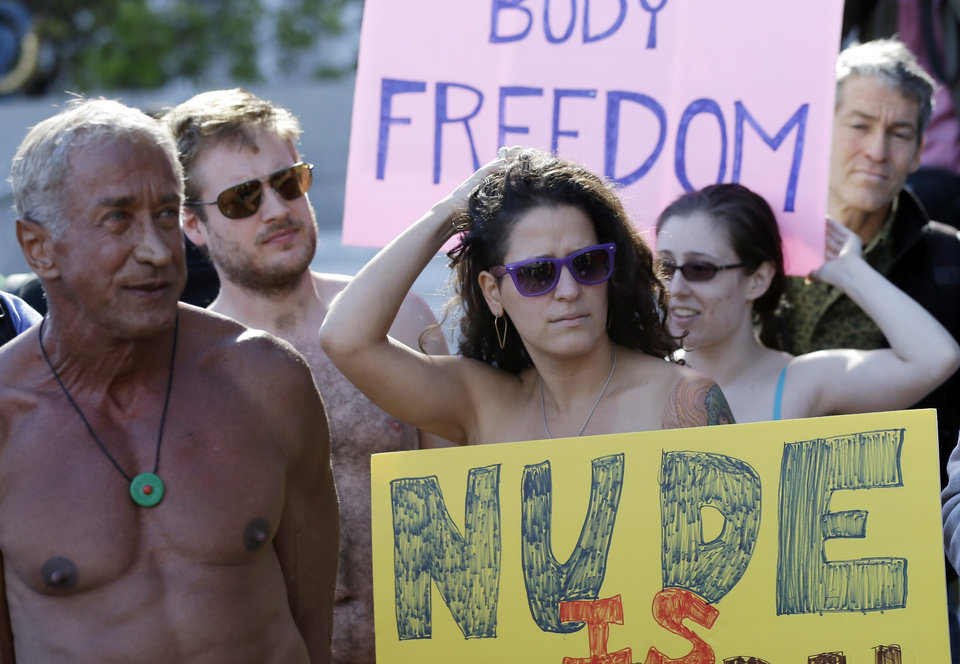 Demonstrators gather outside of City Hall in San Francisco for a protest against a proposed city-wide nudity ban, Wednesday, Nov. 14, 2012. San Francisco appears poised to shed part of its image as a city where anything goes, including clothing. The Board of Supervisors is scheduled to vote next week on a law that would ban public nudity. The proposal comes in response to a devoted group of nudists who proudly strut their stuff through the city's Castro District. (AP Photo/Marcio Jose Sanchez)