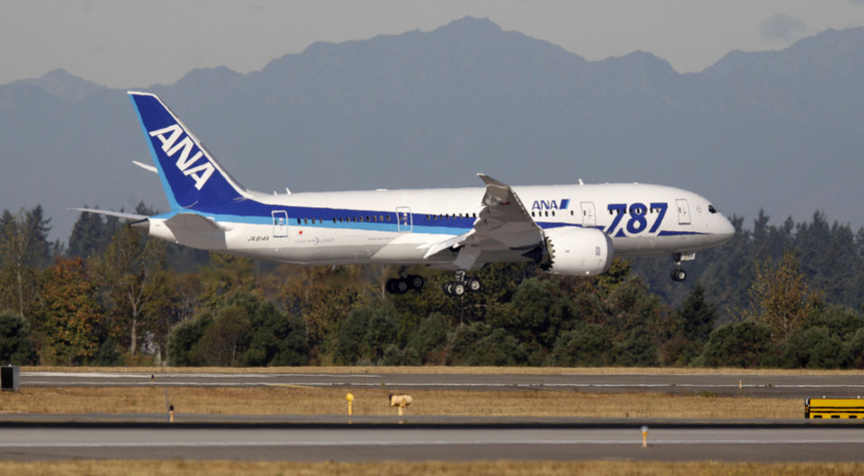 Photo -   A Boeing 787 operated by All Nippon Airways lands at Seattle-Tacoma International Airport, Monday, Oct. 1, 2012, on the first day of service for the 787 on ANA's Seattle-Tokyo route. (AP Photo/Ted S. Warren)