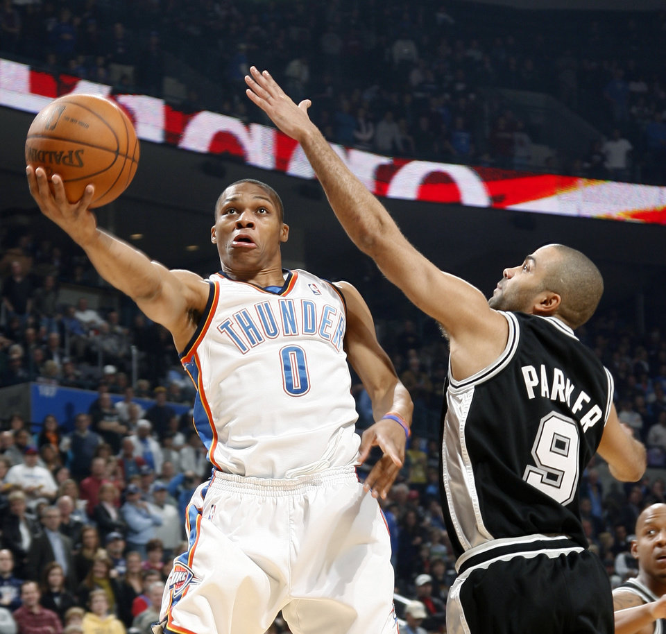 Oklahoma City's Russell Westbrook goes past San Antonio's Tony Parker during the NBA basketball game between the Oklahoma City Thunder and the San Antonio Spurs at the Ford Center in Oklahoma City, Wednesday, January 13, 2010. Photo by Bryan Terry, The Oklahoman