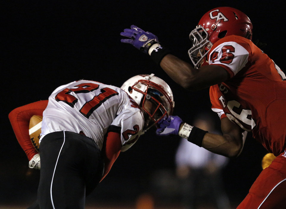 Carl Albert's Dillon Lohr (26) grabs Claremore's Jordan Cunningham (21) by the face mask during a high school football game between Carl Albert and Claremore in Midwest City, Friday, Nov. 16, 2012.  Photo by Garett Fisbeck, The Oklahoman