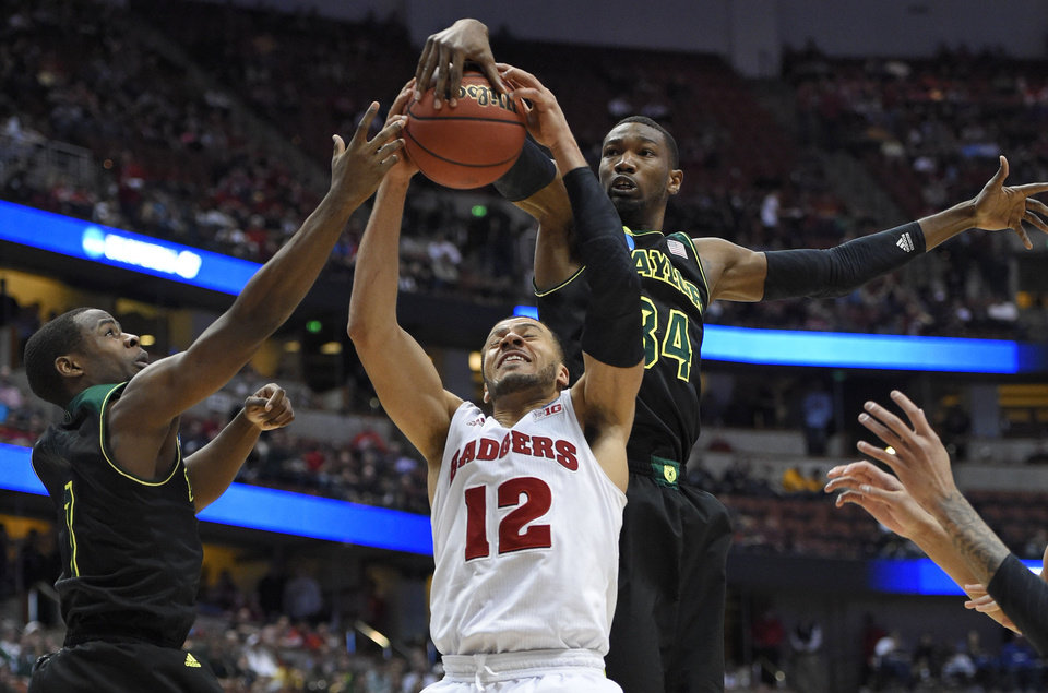 Photo - Wisconsin guard Traevon Jackson (12) competes against Baylor forward Cory Jefferson (34) for a rebound during the second half of an NCAA men's college basketball tournament regional semifinal,Thursday, March 27, 2014, in Anaheim, Calif. (AP Photo/Mark J. Terrill)