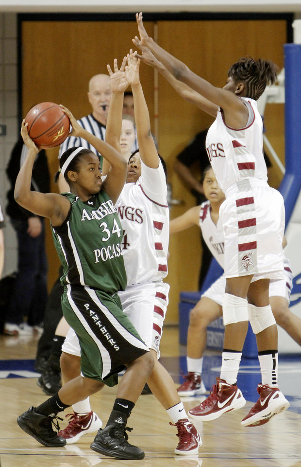 NE #14 Maximina Gonzalez and NE #1Lanesia Williams defend against A-P #34 Dontasia McAfee during a 2A girls high school semi-final basketball game between Northeast and Amber-Pocasset at Oklahoma City University Thursday , March 8, 2012. Photo by Doug Hoke, The Oklahoman