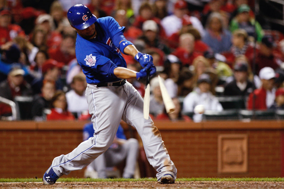 Photo - Chicago Cubs' Welington Castillo breaks his bat as he hits a single during the sixth inning of a baseball game against the St. Louis Cardinals on Tuesday, May 13, 2014, in St. Louis. (AP Photo/Scott Kane)