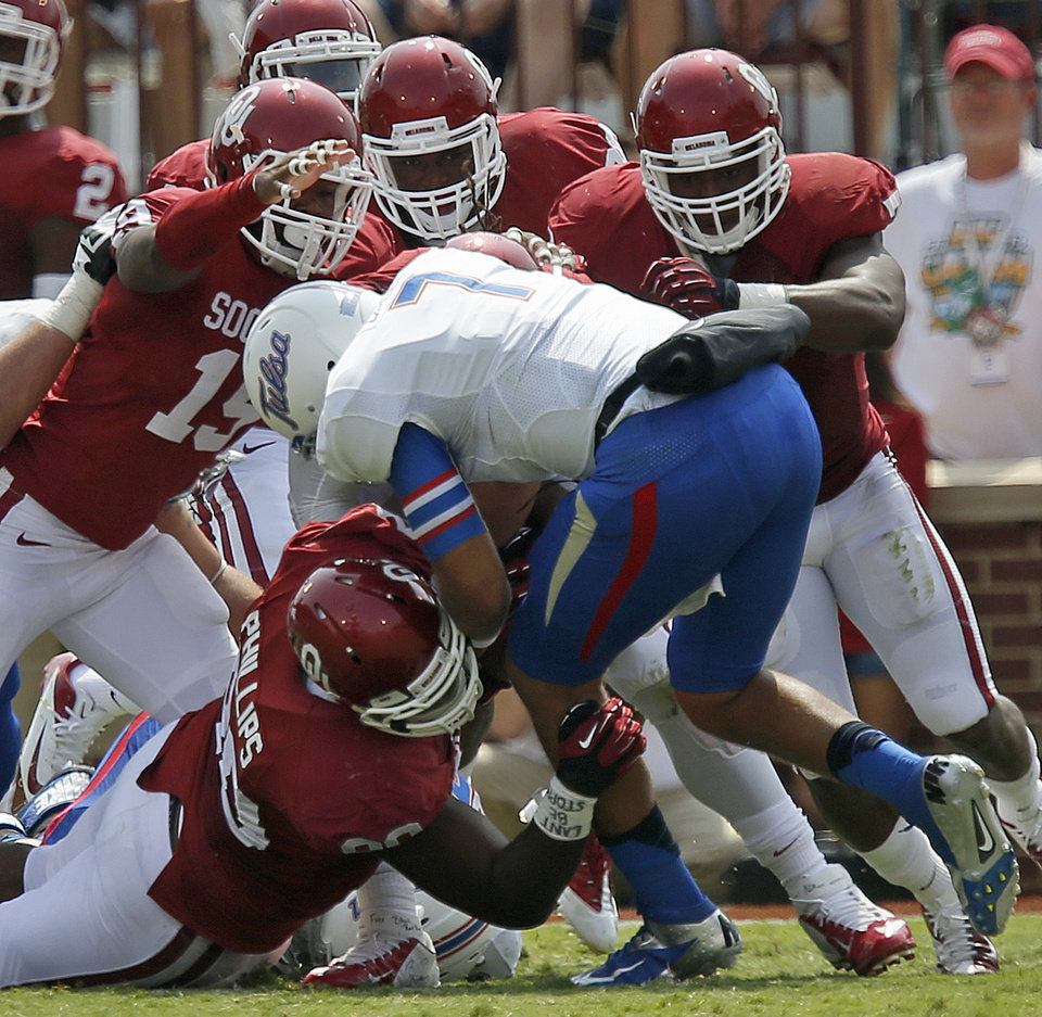 Tulsa's Cody Green (7) is brought down by a gang of Oklahoma defenders during a college football game between the University of Oklahoma Sooners (OU) and the Tulsa Golden Hurricane at Gaylord Family-Oklahoma Memorial Stadium in Norman, Okla., on Saturday, Sept. 14, 2013. Oklahoma won 51-20. Photo by Bryan Terry, The Oklahoman
