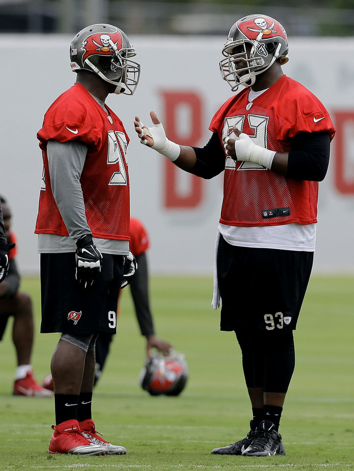 Tampa Bay Buccaneers defensive tackle Gerald McCoy (93) talks to Clinton McDonald (98) during an NFL football minicamp Wednesday, June 11, 2014, in Tampa, Fla. (AP Photo/Chris O'Meara)  <strong>Chris O'Meara</strong>