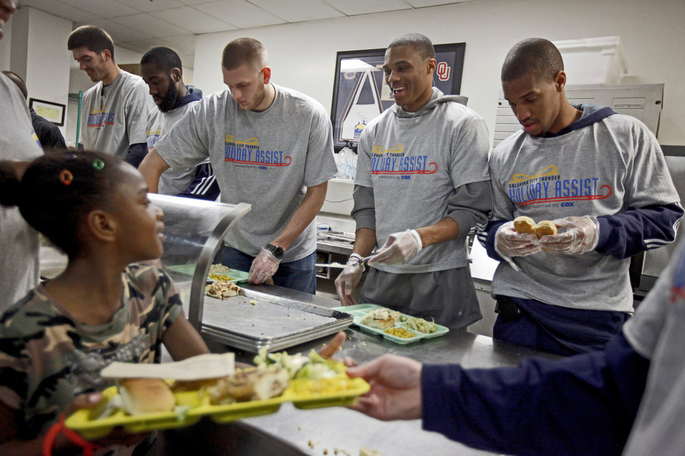 Oklahoma City Thunder NBA players from left, Byron Mullens, James Harden, Cole Aldrich, Russell Westbrook, and Eric Maynor serve Thanksgiving dinner at the City Rescue Mission in Oklahoma City, Tuesday, Nov. 23, 2010. Photo by Bryan Terry, The Oklahoman ORG XMIT: KOD
