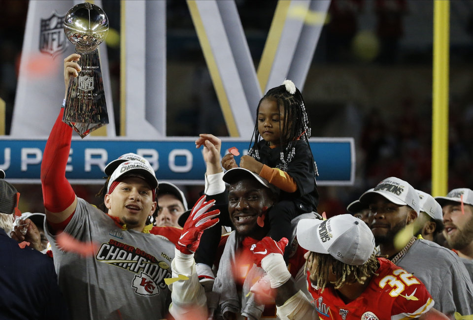 Photo - Kansas City Chiefs quarterback and MVP Patrick Mahomes celebrates with Frank Clark and Tyrann Mathieu (32) after the NFL Super Bowl 54 football game against the San Francisco 49ers Sunday, Feb. 2, 2020, in Miami Gardens, Fla. The Kansas City Chiefs won 31-20. (AP Photo/Mark Humphrey)