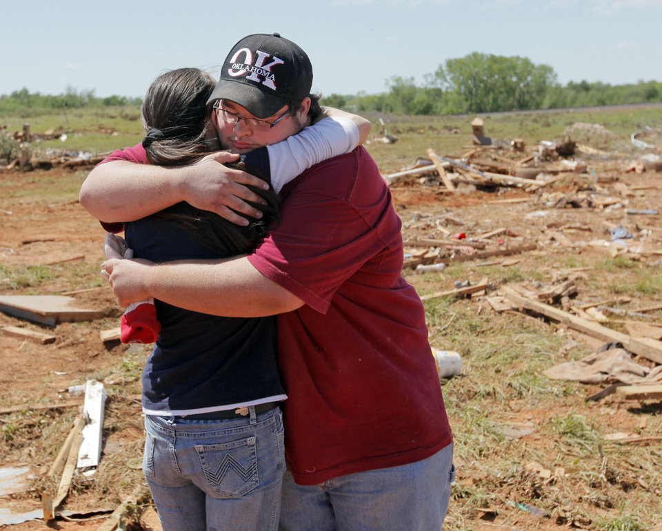 Andrea Rush, left, gets a hug from Timothy Walser at the Hide-A-Way Mobile Home Park in Woodward, Okla., Monday, April 16, 2012. Rush\'s friend Steve Peil was killed by a tornado that struck the town early Sunday morning. Members of Walser\'s family knew Peil. Walser was at the site helping to clean up the debris from destroyed homes, including one in which his cousins lived. Photo by Nate Billings, The Oklahoman