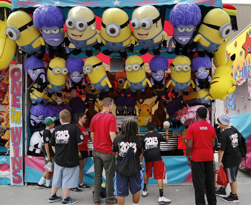 Students from Bishop Public Schools in Lawton play games on the midway during  the opening day of the  2013 Oklahoma State Fair   on Thursday, Sep. 12, 2013.  The trip to the fair is an annual outing for students, teachers and parents. About 250 students came to the fair Thursday. Photo by Jim Beckel, The Oklahoman.