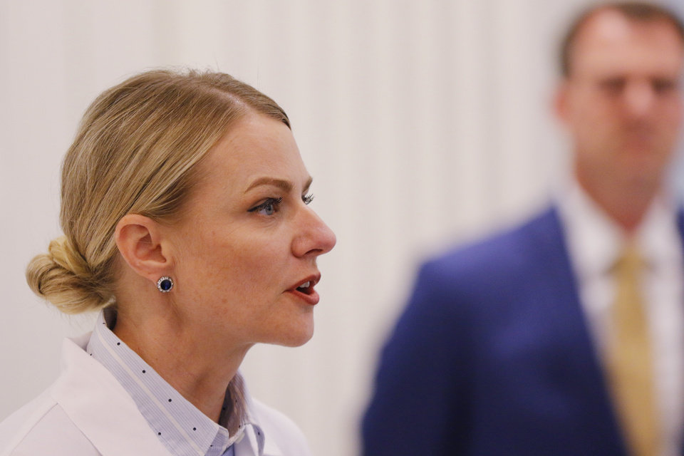 Photo - Kayse Shrum addresses the the media during a briefing for the Governor's Solution Task Force to provide an update on Oklahoma's COVID-19 response in the Blue Room of the Capitol Wednesday, April 15, 2020.  [Photo by Doug Hoke/The Oklahoman]